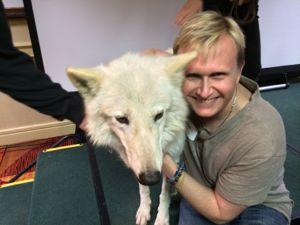 Hugging Maya the Wolf